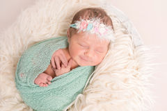 Aorable cute baby smiling in sleep, closeup Royalty Free Stock Image