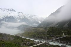 Mt. Cook in mist New Zealand Tasman Glacier View Track. Aoraki / Mount Cook is the highest mountain in New Zealand. Its height since 2014 is listed as 3,724 royalty free stock photos