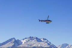 AORAKI MOUNT COOK, NEW ZEALAND 16TH APRIL 2014; Unidentified helicopter flying over the amazing South Island, New Zealand. AORAKI MOUNT COOK, NEW ZEALAND 16TH Royalty Free Stock Images
