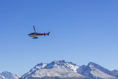 AORAKI MOUNT COOK, NEW ZEALAND 16TH APRIL 2014; Unidentified helicopter flying over the amazing South Island, New Zealand. AORAKI MOUNT COOK, NEW ZEALAND 16TH Stock Photography
