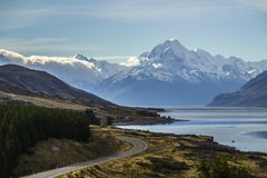 Aoraki/Mount Cook, road and turquoise lake Pukaki view from Peter´s Lookout royalty free stock image