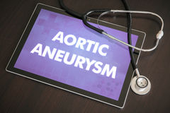 Aortic aneurysm (heart disorder) diagnosis medical concept on ta. Blet screen with stethoscope royalty free stock image