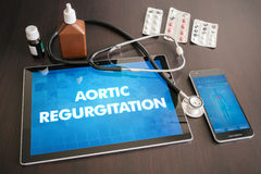 Aortic regurgitation (heart disorder) diagnosis medical concept. On tablet screen with stethoscope stock image