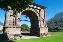 Aosta, the Aosta Valley, Italy, Europe. View of the Arch of August on July 29, 2016. The Arch of August was built in 25 BC for the Roman victory over the Royalty Free Stock Photography