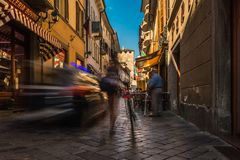 Aosta city center street road people walk fast for shopping stock image