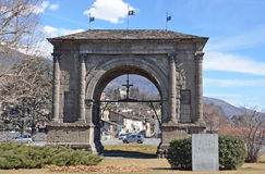 Aosta, Italy,March, 10, 2013. Italian scene: Cars near the arch of Augustus, built a 25 year BC Royalty Free Stock Image