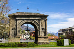 Aosta romanic arch. Romanic arch on a blue cloudy sky Stock Photos