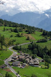 Aosta Valley. Group of houses along a road in a slope of the Valle d'Aosta Royalty Free Stock Photography