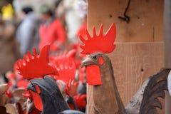 Aosta valley local handicraft, wooden cockerel sculpture royalty free stock images
