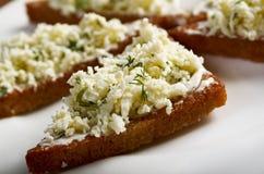 Apéritif, grillé avec le fromage blanc Photos libres de droits