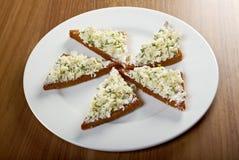 Apéritif, grillé avec le fromage blanc Image stock