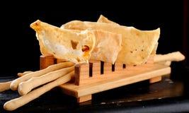 Apéritifs italiens dinants fins, batons de pain de Grissini Photos libres de droits