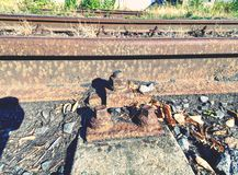 Rusty train railway detail, oiled sleepers and stones between rail way. Ap with nut and on the old rusty rail. Rusty train railway detail, oiled sleepers and stock photo