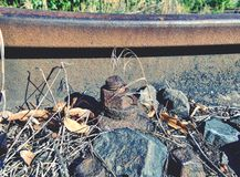 Rusty train railway detail, oiled sleepers and stones between rail way. Ap with nut and on the old rusty rail. Rusty train railway detail, oiled sleepers and stock photos