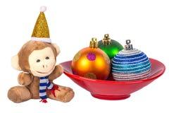 Apa för nytt år och färgrika bollar Royaltyfri Fotografi