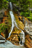 The Apa Spanzurata waterfall in the Latoritei gorge. Beautiful view of a waterfall in the mountains going down the steep rocks Stock Photo