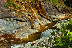The Apa Spanzurata waterfall in the Latoritei gorge. Streams of small waterfalls in the mountains Royalty Free Stock Photography
