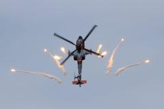 Apache firing flares Stock Photo