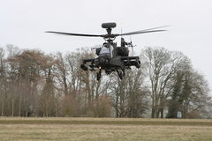 Apache Gunship. An Apache Helicopter in a steady hover during a training mission royalty free stock image