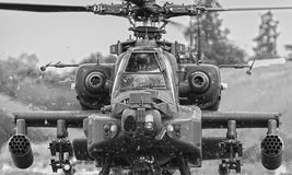 Apache helicopter. Apache attack gunship helicopter front on, weapons loaded