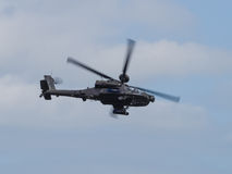 Apache helicopter. Duxford, UK - May 23rd 2015: An Apache Helicopter of the British Army, flying at Duxford VE Day Airshow Royalty Free Stock Image
