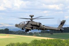 Apache Helicopter on military exercise in Europe. A close up image of a low flying Apache helicopter during a military excersise Stock Photo
