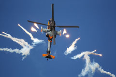 Apache helicopter shoots flares Stock Images