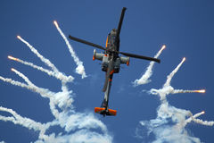 Apache helicopter shoots flares stock image