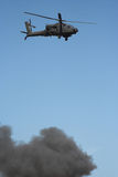 Apache helicopter in a warzone. Apache helicopter in flight in a warzone royalty free stock photos