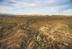 Apache Junction area, Arizona. Overlooking view of Apache Junction near Phoenix, Arizona. Endless curving road running to the horizon Stock Images
