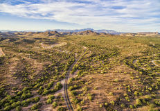 Apache Junction landscape, Arizona. Overlooking view of Apache Junction near Phoenix, Arizona. Endless curving road running to the horizon Picture was taken 4th stock images