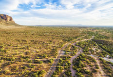 Apache Junction panorama, Arizona. Overlooking view of Apache Junction near Phoenix, Arizona. Endless curving road running to the horizon. Picture was taken 4th royalty free stock image