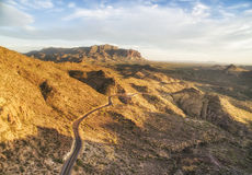 Apache Junction scenic route at sunset lights, Arizona. Overlooking view of Apache Junction scenic route near Phoenix, Arizona. Endless curving road running to stock photography