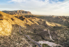 Apache Junction scenic route at sunset lights,  Arizona. Overlooking view of Apache Junction scenic route near Phoenix, Arizona. Endless curving road running to Stock Photos