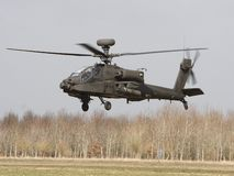 Apache Landing. AH-64 Longbow Apache hovers to land during a training mission stock photos