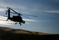 Apache Over Dunes Stock Photos