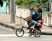Сapacious bike. A family of three people riding a small bike down the street in Varadero Royalty Free Stock Photo