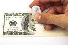 Apagando o dólar Imagens de Stock