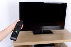 Apagar la TV Imagenes de archivo