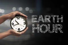 Apague la luz en el minuto 60 con el mensaje de la hora de la tierra Fotografía de archivo