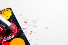 Apague o débito do cartão de crédito Fotografia de Stock