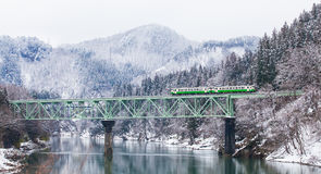 Apan mountain and snow with local train Stock Photography