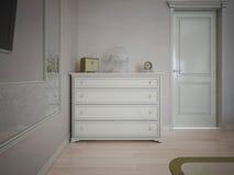 Aparador blanco en dormitorio con las paredes poner crema Fotos de archivo libres de regalías