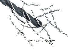 Aparas da broca e do metal no branco Imagens de Stock Royalty Free