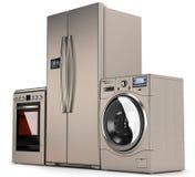 Aparatos electrodomésticos, refrigerador, lavadora y una estufa de gas Fotografía de archivo libre de regalías