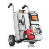 Aparatos electrodomésticos en el carro de la compra Fotografía de archivo libre de regalías