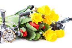 Aparejos de pesca con las flores de la primavera Fotografía de archivo libre de regalías