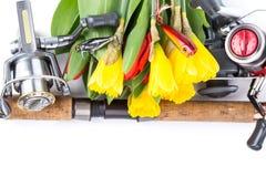 Aparejos de pesca con las flores de la primavera Imagen de archivo libre de regalías