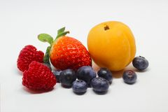 Various Fruits on a White Background. This is apart of a collection of images of various fruits taken on different backgrounds. Experimenting with a Lightbox and Royalty Free Stock Photo