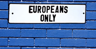 Apartheid sign europeans only blue brick wall. Sign from the apartheid era in south africa saying europeans only against blue brick wall Stock Photos